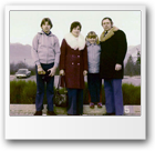 Jarek age 13 in parking lot with Mom, Dad and Renata